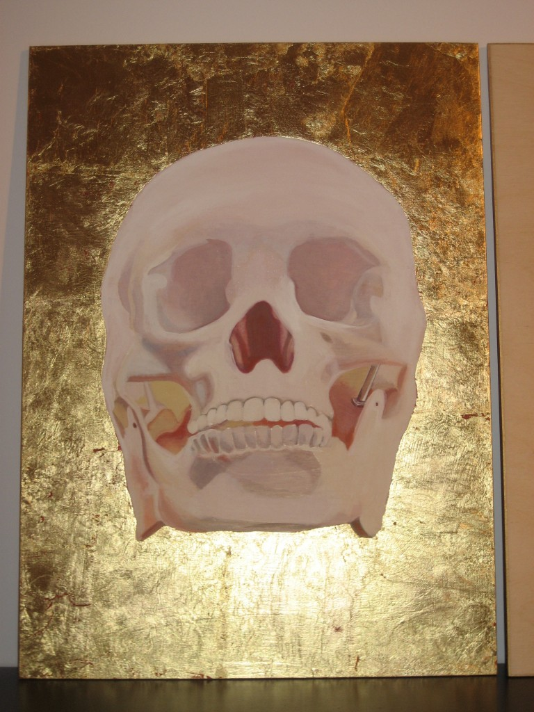a skull with gold leaf