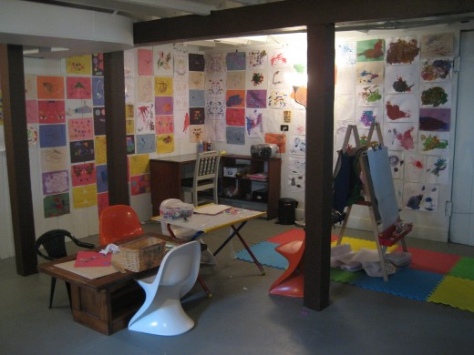 "The boys' ""studio""- I love the colorful art lining the walls!"